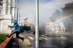 (. . .) Tags: valparaiso chile photojournalism marcha protest street people water rainbow arcoiris colors blue