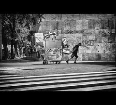 A Heavy Load (EddyB) Tags: barcelona blackandwhite bw blancoynegro europa europe fuji bcn streetphotography catalonia catalunya fujinon catalua barcelone pasocebra eddyb humanfactor xt1 factorhumano xf1855f284mm