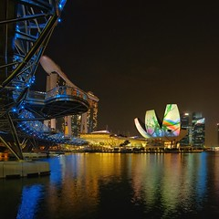 City Lights (Krist Setyawan) Tags: city bridge architecture night buildings landscape singapore cityscape nightscape outdoor reservoir citylights cityview waterscape marinabay helixbridge marinabaysands
