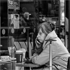 Good morning (John Riper) Tags: johnriper street photography straatfotografie square bw black white zwartwit mono monochrome candid john riper canon 6d 24105 l liverpool england uk people waiting limestreet limestreetstation woman asleep eyes closed window shop coffee phone ringing costa top employer cctv surveillance glass reflection ghost