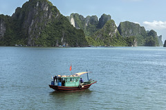 Fishing on Ha Long Bay (tmeallen) Tags: halongbay fishingboat fisherman limestonecliffs karstformations islands unescoworldheritage turquoisewater northvietnam culture