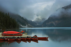 Red Canoes at Lake Louise (lfeng1014) Tags: redcanoesatlakelouise redcanoes lakelouise lake mountain mistymorning mist reflection cloud cloudy lowcloud calm canon5dmarkiii lifeng banff alberta canada