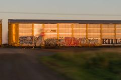 16-7381 (George Hamlin) Tags: minnesota sax railroad freight train manifest auto rack carrier graffiti sunset canadian national cn northbound pan motion grade crossing photo decor george hamlin photography