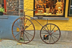 Rough Ride (David K. Edwards) Tags: old sculpture window bicycle yellow shop ancient belgium display snapshot decoration bruges unplanned unsolicited toocentered