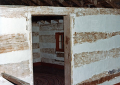 Interior, Murphy Log House — Perry Township, Brown County, OH (Pythaglio) Tags: county door ohio red brown house film window saint st wall farmhouse early woodwork photo 1982 log martin farm daniel interior painted logs places historic doorway national scanned rug register residence twostory perry exposed murphy township rafters dwelling hewn chinking nrhp daubing crosswall hewed sixpane ca1806