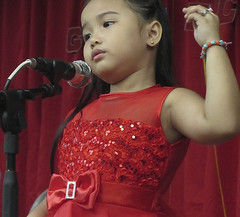 Speaking to the Crowd (mikeeliza) Tags: red portrait brown cute public armpit girl beautiful youth asian photography pretty child hand dress arms arm skin candid philippines fingers young speaker manila microphone pinay filipina talking mikeeliza