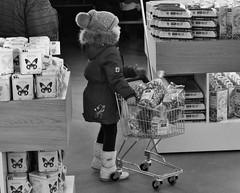 when children shopping (heiko.moser) Tags: street people bw streetart kids canon shopping children leute noiretblanc candid strasse kinder nb menschen sw schwarzweiss nero blackwihte