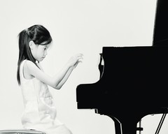 young performer (-liyen-) Tags: music performance recital piano pianist performer concert blackandwhite live candid fujixt1 highkey focus concentration challengeyouwinner