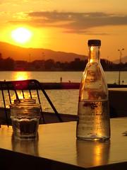 Δυση ηλιου Αιγιο DSC03115 (omirou56) Tags: 43 αιγιο αχαια πελοποννησοσ sonydscwx500 ελλαδα δυσηηλιου αιγιαλεια ουρανοσ μπουκαλι τραπεζι κιτρινο χρωμα sunset aigio achaia greece sky yellow bottle outdoor