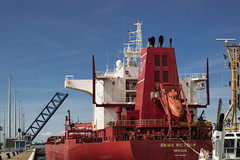 Large container ship (TouTouke - Nightfox) Tags: world ocean blue sea sky industry water colors station port work river boat store big dock track industrial european factory ship commerce outdoor many transport large lot wave zeeland terminal cargo stack storage container business busy bow transportation sail shipping trade weight carrier freight loading logistics export bulk unloading terneuzen