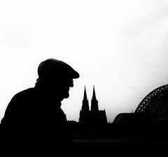 Cologne II (Dan-Schneider) Tags: street streetphotography schwarzweiss schneider silhouette blackandwhite bw best camera candid cologne urban human europe einfarbig people photography prime lens light portrait monochrome moment mft mood olympus omdem10 decisive bridge church