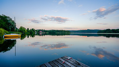 Amulet (TanzPanorama) Tags: nature boat reflection cloud bluehour scenery glaciallake sony sonya7ii ilce7m2 fe1635mmf4zaoss variotessartfe1635mmf4zaoss zeiss tanzpanorama flickr dusk water lake waterscape sky symmetry lakedistrict kashubianswitzerland pier jetty evening szwajcariakaszubska poland summer lee leefilter 09ndgrad