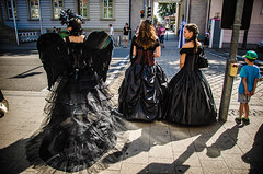 Crossing (Melissa Maples) Tags: ludwigsburg germany europe nikon d5100   nikkor afs 18200mm f3556g 18200mmf3556g vr venetianfestival venezianischemesse trafficlight wings mask black costumes women crosswalk street
