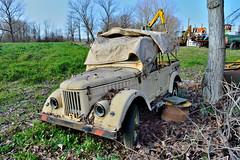 gaz 69 (riccardo nassisi) Tags: car wreck rust rusty relitto rottame ruggine ruins scrap scrapyard sfascio sfasciacarrozze epave escavatore excavator hydromac abbandonata abbandonato abandoned auto