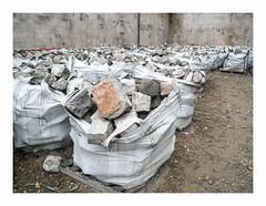 Mer de sacs (hlne chantemerle) Tags: photosderue pavs grs cubes sacs accumulation murs sol terre monochrome sandstone cobblestones bags walls ground beige streetphoto