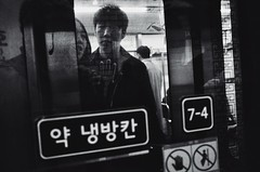 ((Jt)) Tags: blackandwhite monochrome underground subway asia metro candid flash streetphotography korea seoul ricoh compactcamera koreanguy koreangirl streettogs jtinseoul