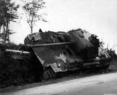 "Destroyed and burnt down Pz.Kpfw. V Ausf. G ""Panther"" heavy tank in a ditch by the roadside in the Battle of France"