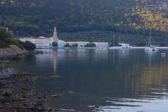 Morning (yuriye) Tags: sea reflection church water sunrise island greek bay gulf ngc greece harmony eternity symi panormitis