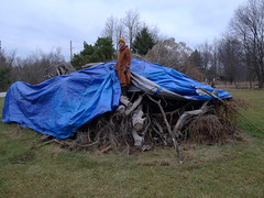 Samanera Khema covers up the New Year's Eve bonfire with a tarp