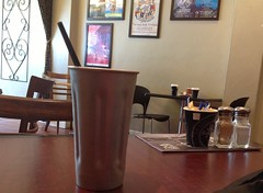 Just having my second, most expensive milkshake in the world (spelio) Tags: travel stilllife coffee shop table pepper salt australia email canberra shakers act oconner ipad australiancapitalterritory 2015 39steps