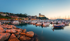Lerici Sunset (Philipp Klinger Photography) Tags: italien blue trees sunset red sea summer sky italy orange moon seascape reflection tree castle water rock architecture port marina reflections landscape boats lights hotel evening harbor boat nikon rocks warm europa europe mediterranean italia mare sailing harbour yacht liguria warmth hour sail bluehour philipp mediterraneansea d800 fortezza klinger lerici ligurien fortezzadilerici