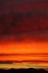 Sunrise 12 31 14 #41 (Az Skies Photography) Tags: morning red arizona sky orange cloud sun black rio yellow skyline clouds sunrise canon skyscape eos rebel gold dawn golden december salmon az rico rise 31 daybreak 2014 arizonasky riorico rioricoaz arizonasunrise t2i 123114 arizonaskyline canoneosrebelt2i eosrebelt2i arizonaskyscape 12312014 december312014