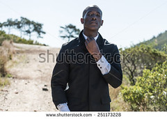 stock-photo-african-black-male-model-wearing-black-suit-with-white-unbuttoned-shirt-standing-on-gravel-path-251173228 (Soft Focus Photography) Tags: road white mountain man black sexy male men fashion businessman shirt modern standing dark walking person model open looking adult body path walk african background coat young formal handsome style professional business suit pack tuxedo american topless attractive elegant six toned success isolated unbuttoned gravel confident stylish