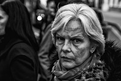 A Stern looking women - IMG_1758-Edit (roger_thelwell) Tags: life street city uk winter portrait england people urban bw white black streets cold london lamp monochrome westminster beauty hat rain leather mobile umbrella hair bag walking real photography mono women chat shiny phone looking traffic post natural photos britain circus cigarette candid cab taxi great over sac hats cell photographic smoking lamppost photographs oxford conversation shiney talking shoulder stern handbag stud speak speaking studs commuters a scak