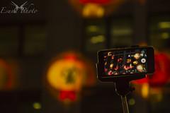 The Year of the Selfie Stick (Esuna Photo) Tags: street red orange night sydney chinesenewyear georgestreet iphone lampoons selfiestick