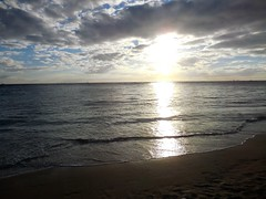 sunset reflection (kenjet) Tags: ocean sunset sun reflection beach water weather clouds hawaii evening pacific waikiki oahu pacificocean waikikibeach