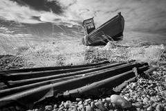 Going nowhere - Dungeness, Kent (binliner) Tags: old abandoned beach mono coast boat kent fuji desert debris shingle infrared dungeness fishingboat deserted 14mm xpro1