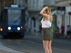 Zagreb street moment (ergas248) Tags: canon 7d mk2 mark ii ef 70200 f28 zagreb 2016 tram girl woman female tourist model posing hands figure young shorts warm blue open trg bana jelacica people
