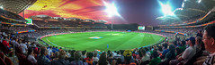 More action in the sky than on the pitch (*ScottyO*) Tags: sunset people panorama orange sport yellow night clouds lights evening purple stadium crowd australia cricket adelaide sa southaustralia oval iphone