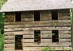 Facade, William Knoles Log House — Chillicothe, Ohio (Pythaglio) Tags: county door wood trees roof ohio house man green film sign early photo ross log interior shingle shell logs william historic steeple scanned moved chillicothe residence twostory exposed notrespassing openings rafters dwelling joists relocated hewn notching hewed knoles sidehallway ca1990 ca1820 threebay