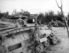 German remains of a Panther tank and SdKfz 251 #1134 vehicle inspected by American soldiers somewhere in Normandy.