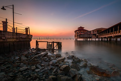 Eureka (zollatiff) Tags: ocean longexposure morning travel sunset sea seascape reflection beach nature water colors architecture sunrise buildings landscape dawn restaurant pier twilight nikon scenery rocks cityscape waterfront outdoor jetty horizon structures peaceful calm malaysia bluehour penang tranquil eureka foreground waterscape leadingline nikond7100 flickrstruereflection2 zollatiff nikkor1012
