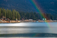 At the End of the Rainbow - Bass Lake (Darvin Atkeson) Tags: california lake mountains reflection rain misty fog forest rainbow glow sierra resort pines basslake downpour illuminate 2015 darvin darv lynneal yosemitelandscapescom