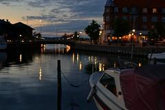(OsvaldPhoto) Tags: city bridge light sunset water dark lights boat dock afternoon cloudy manmade