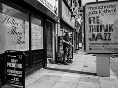 Northern Quarter #101 (Peter.Bartlett) Tags: manchester noiretblanc shopfront window unitedkingdom people city doorway urbanarte streetphotography doubleyellowlines peterbartlett man urban shutter monochrome uk m43 microfourthirds poster bw lunaphoto sign blackandwhite candid olympuspenf brush tattoo piercing jazz