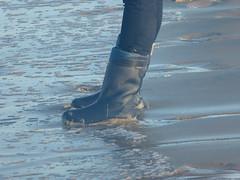Playing with the waves 11 (willi2qwert) Tags: rubberboots rainboots regenstiefel wellies wellingtons wasser women wet water wave watt beach gummistiefel gumboots girl strand