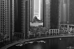 Gap between buildings - Dubai Marina, UAE (kadryskory) Tags: kadryskory bw blackandwhite monochrome bnw dubai dubaimarina water marina uae marinawalk marinapromenade buildings city urban jbr marinajbr architecture yachts boats skyscrapers travel trip