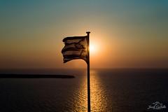Greek Flag. (Jordi Corbilla Photography) Tags: santorini greece jordicorbilla jordicorbillaphotography nikon d750 50m 50mm f18 sunset pastel colours flag