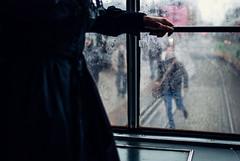 hold the door! (ewitsoe) Tags: run rian traminside rearview street city man woman morning commute ewitsoe nikond80 35mm urban cityscape poznan poalnd europe rain autumn raining