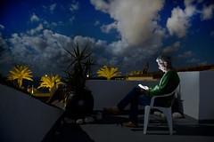 Rooftop Reading (timm999flickr) Tags: menorca balearics army barracks abandoned sea thunderstorms iridiumflare anticrepuscularrays sunrise sunset montetorre alcaufar graffiti portraits birthday bassaverde stlluis calaenporter salgar mammatus startrails