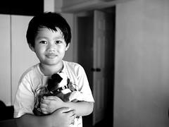 PC210621 (Plototot Tot) Tags: leica light boy portrait window four child natural f14 small son olympus panasonic cameras micro omd thirds 25mm carmelo em5