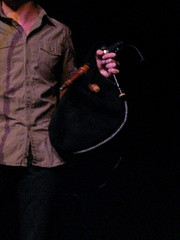 Bagpipes [Double or Single Reed Instruments with a Flexible Air Reservoir] 18: Binou (of Konagon An Hadask) (KM's Live Music shots) Tags: france bretagne bagpipes musicalinstrument biniou royalconcerthall aerophone hornbostelsachs triokonogan