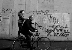 amsterdam (wojofoto) Tags: graffiti wojofoto amsterdam laser314 blackandwhite zwartwit streetphoto straatfoto wolfgangjosten nederland netherland holland mensen people fiets fietsen monochrome streetart kind child bicycle fahrrad bike