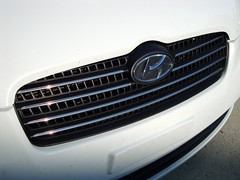 Grill On A 2011 Hyundai Accent. (dccradio) Tags: lumberton nc northcarolina robesoncounty car vehicle hyundai white grill grille emblem bumper front