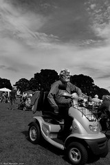 Village fete (13) (Neil. Moralee) Tags: july2016nikond7100 neilmoralee hemyock village fete neil moralee nikon d7100 man matute old laughing funny bald balding shirt moustache happy smile smiling back white mono monochrome bw candid face portrait outdoor people natural light blackdown hills rural event local hat fun summer comunity support devon uk