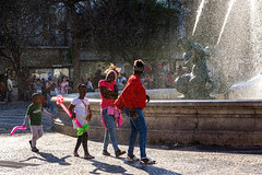 'April 25th ... Freedom Day' (Canadapt) Tags: family woman portugal fountain balloons children lisbon mother spray canadapt